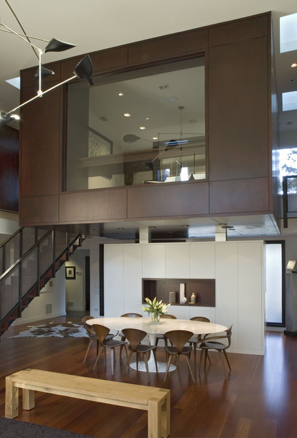 Inspiration for a contemporary dark wood floor dining room remodel in Chicago with white walls