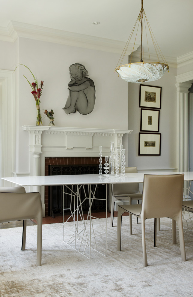 Inspiration for a contemporary dining room remodel in Boston with white walls and a standard fireplace