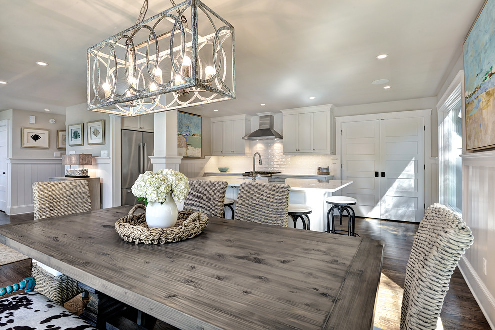 Example of a mid-sized beach style dark wood floor and brown floor kitchen/dining room combo design in Charleston with no fireplace