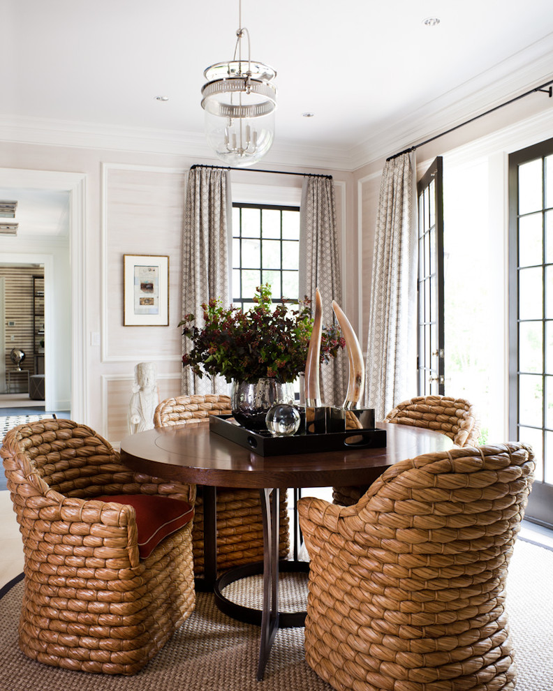 Example of a transitional dining room design in New York with beige walls