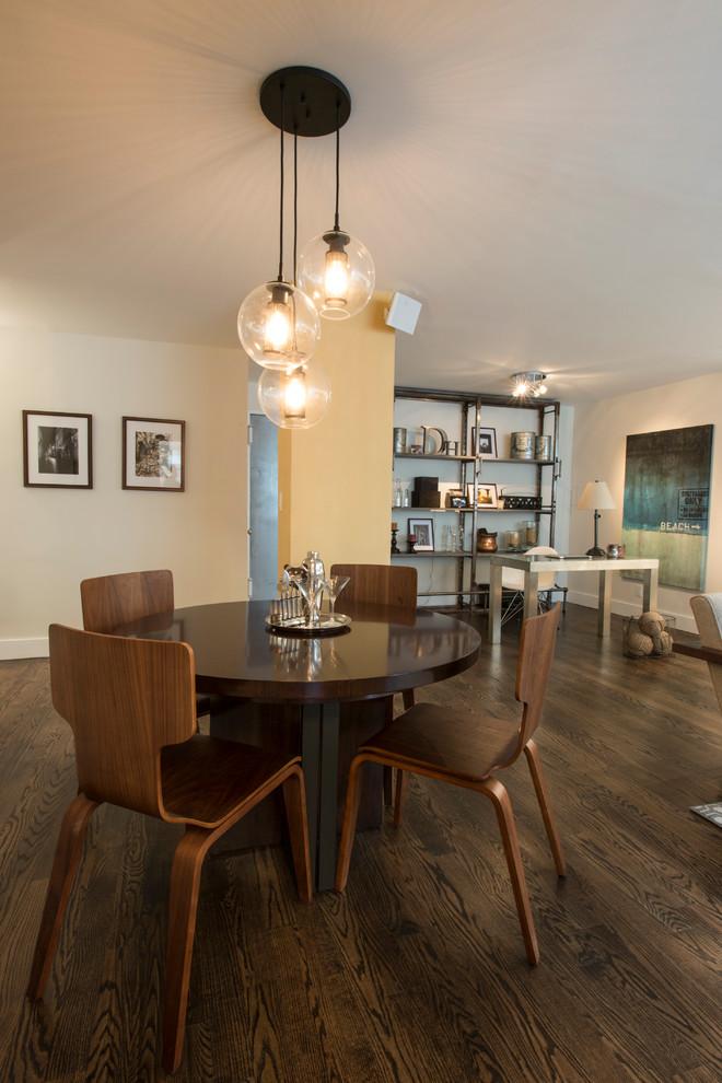 Dining room - industrial dark wood floor dining room idea in New York with beige walls