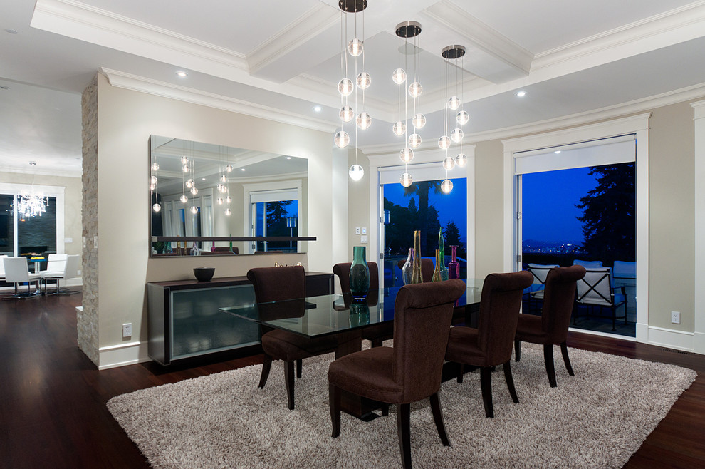 Dining room - large contemporary dark wood floor dining room idea in Vancouver with gray walls