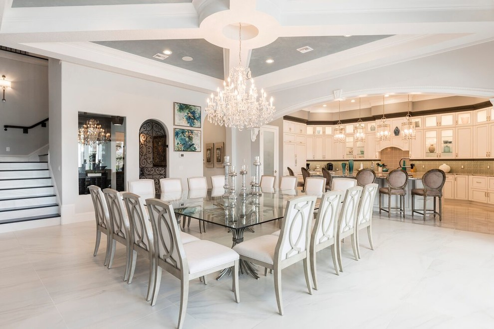Inspiration for a mediterranean gray floor dining room remodel in Orlando with gray walls