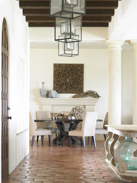 Example of a coastal terra-cotta floor dining room design in Atlanta with white walls