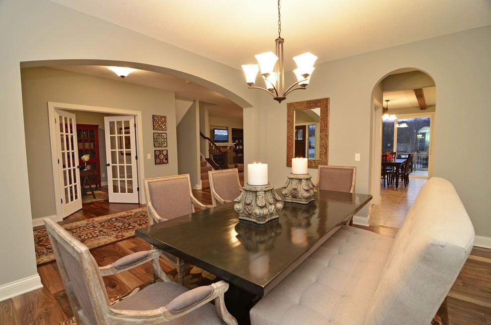 Example of a classic dark wood floor dining room design in Minneapolis with beige walls
