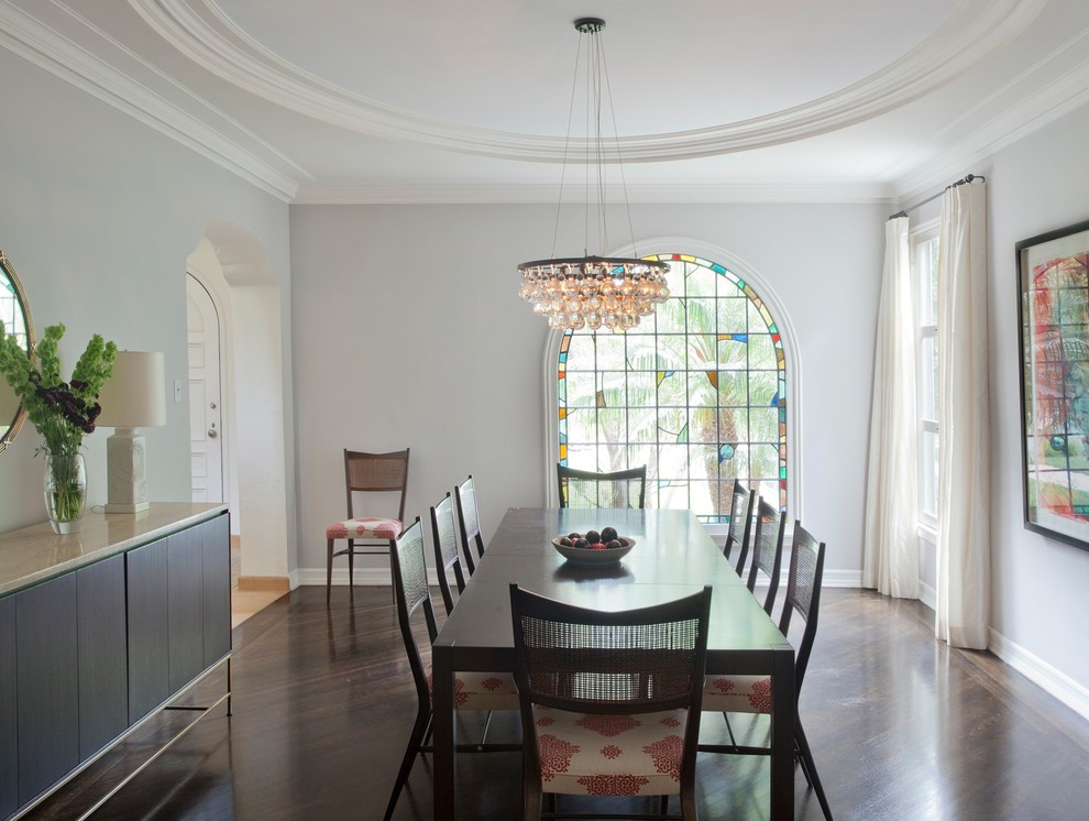 Transitional dark wood floor and brown floor dining room photo in Los Angeles with white walls