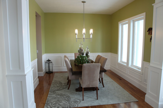 Great room - mid-sized traditional medium tone wood floor great room idea in Salt Lake City with green walls and no fireplace