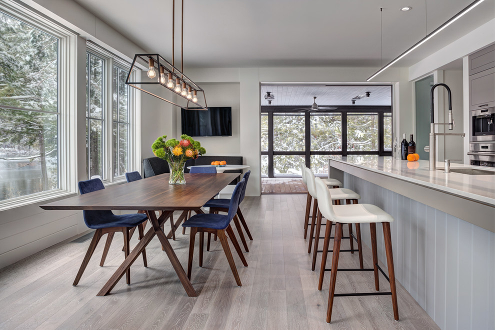 Inspiration for a mid-sized contemporary light wood floor and gray floor kitchen/dining room combo remodel in Bridgeport with gray walls