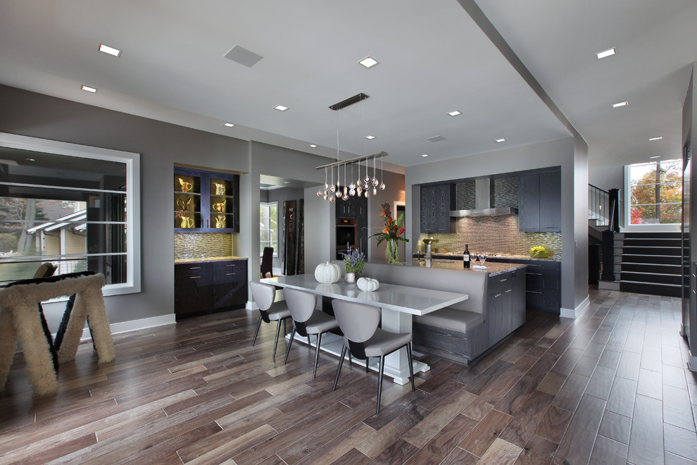Inspiration for a large contemporary medium tone wood floor and brown floor kitchen/dining room combo remodel in Grand Rapids