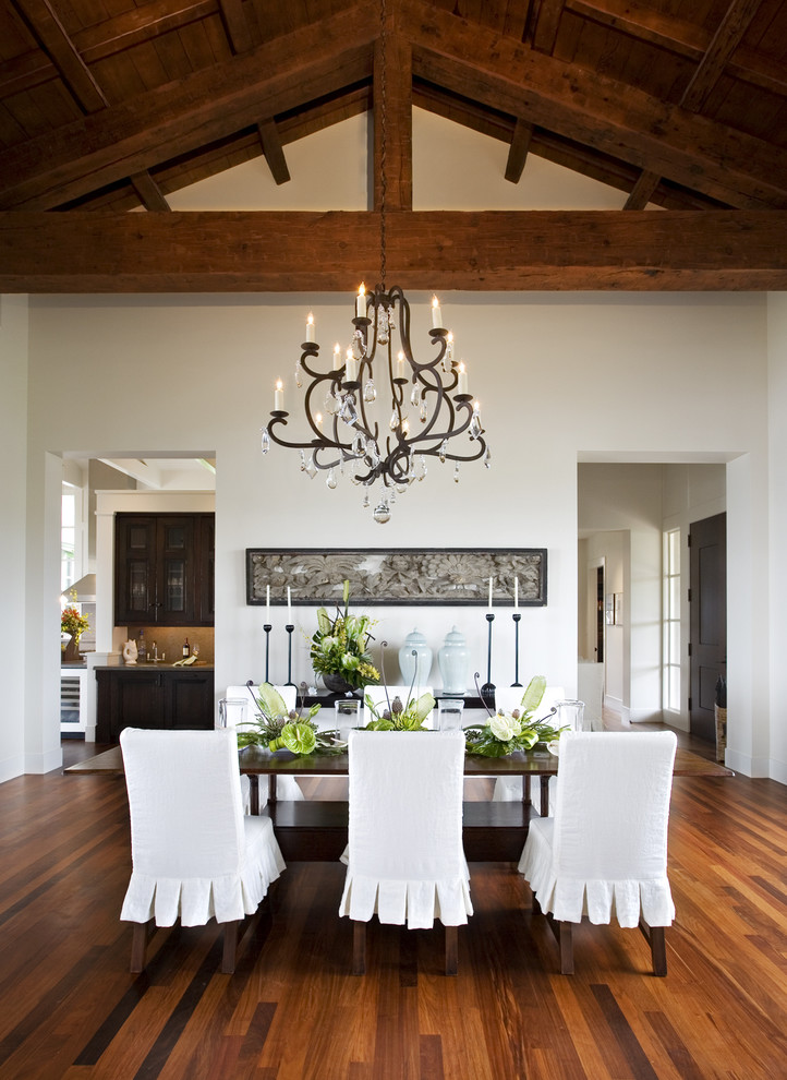 Dining room - tropical dark wood floor dining room idea in San Francisco with white walls