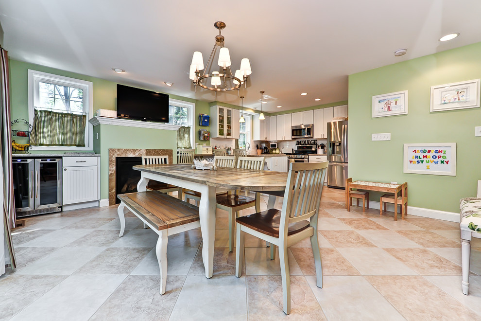 Elegant kitchen/dining room combo photo in DC Metro with green walls and a standard fireplace