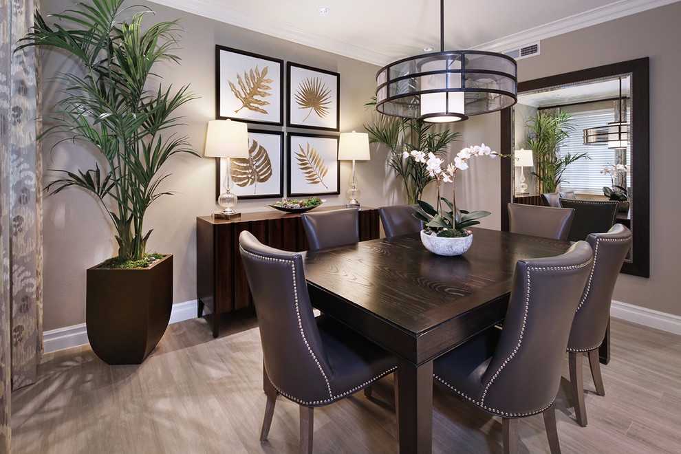 Mid-sized transitional porcelain tile dining room photo in Orange County with gray walls
