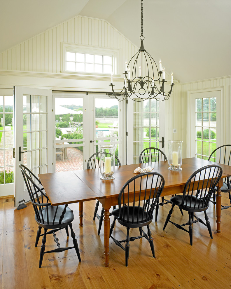 Example of a large country medium tone wood floor great room design in Boston with white walls