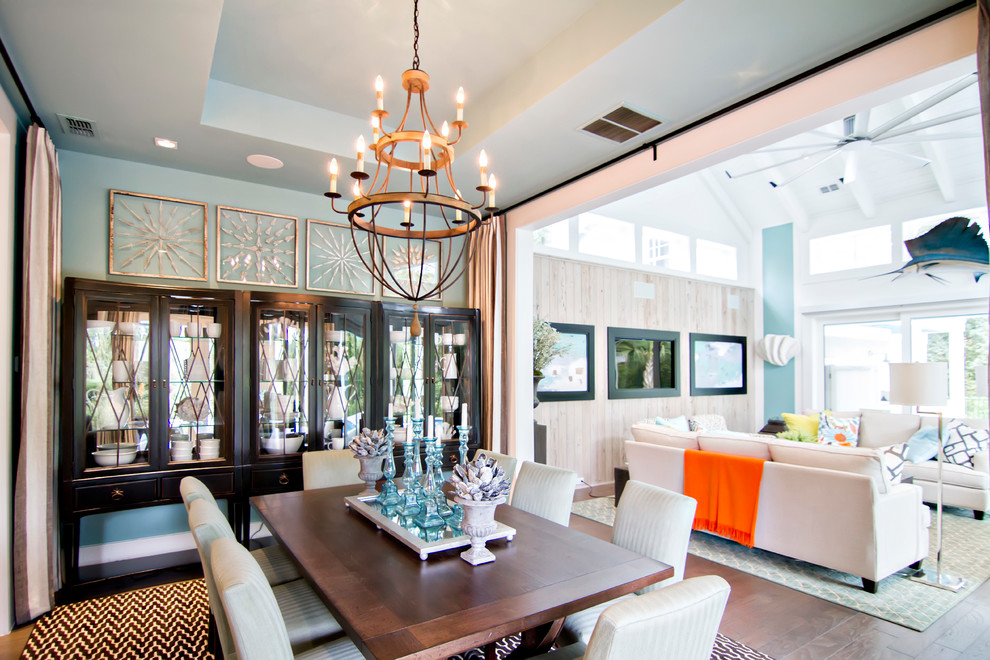 Example of a large beach style medium tone wood floor kitchen/dining room combo design in Jacksonville with blue walls