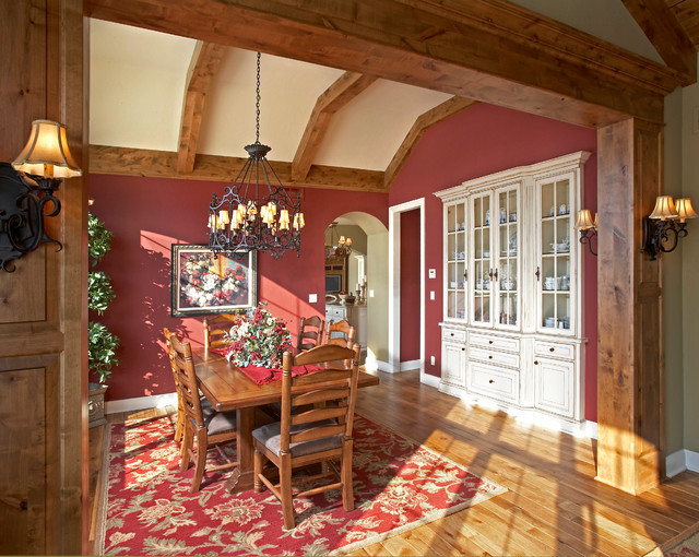 Enclosed dining room - mid-sized traditional medium tone wood floor and brown floor enclosed dining room idea in Milwaukee with red walls and no fireplace