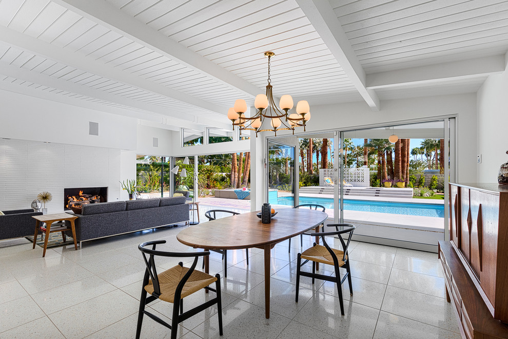 Inspiration for a mid-sized 1960s great room remodel in Other with white walls and no fireplace