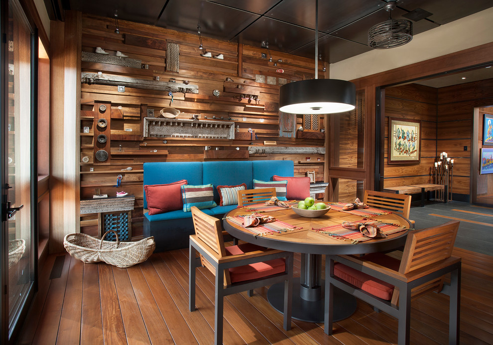 Example of a large southwest medium tone wood floor and brown floor kitchen/dining room combo design in Phoenix with brown walls