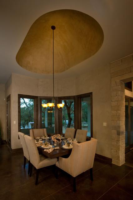 Dining room - transitional concrete floor dining room idea in Austin