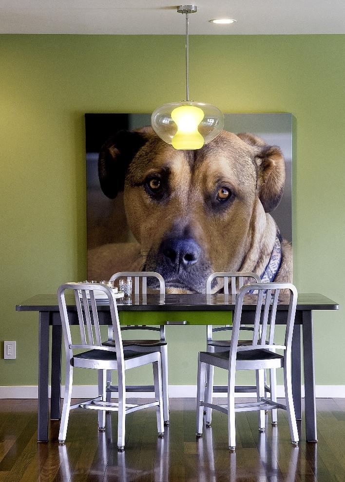Minimalist dark wood floor dining room photo in San Francisco with green walls