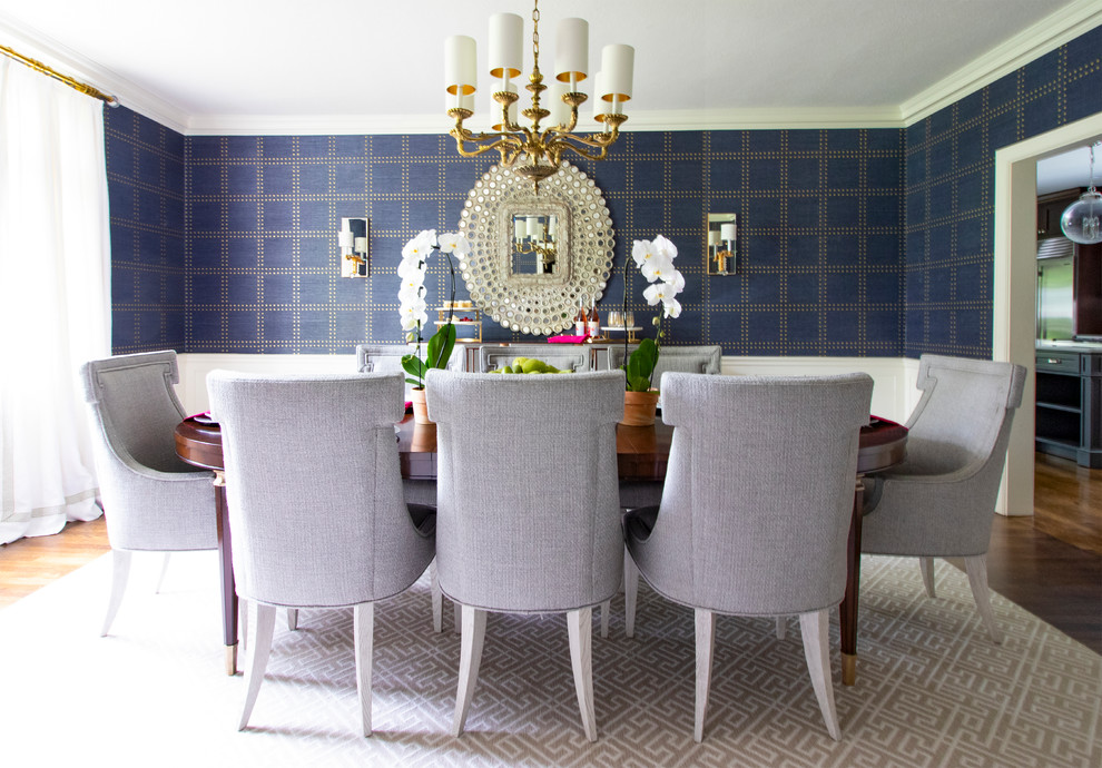 Example of a transitional dark wood floor and brown floor dining room design in New York with blue walls
