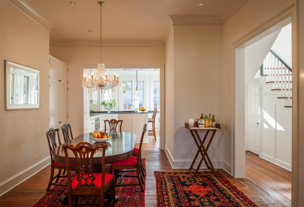 Mid-sized elegant medium tone wood floor and brown floor kitchen/dining room combo photo in DC Metro with white walls and no fireplace