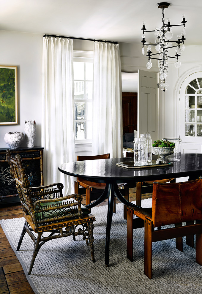 Design ideas for a classic dining room in Chicago with white walls and medium hardwood flooring.