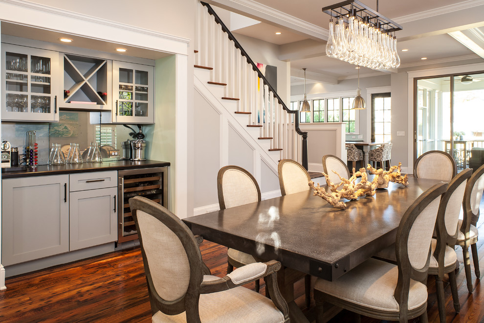 Example of a transitional dark wood floor dining room design in Atlanta with gray walls