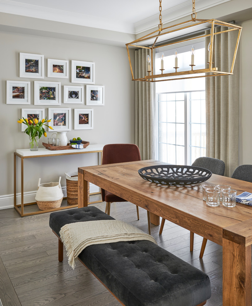 Inspiration for a mid-sized transitional dark wood floor and brown floor dining room remodel in Toronto with gray walls and no fireplace