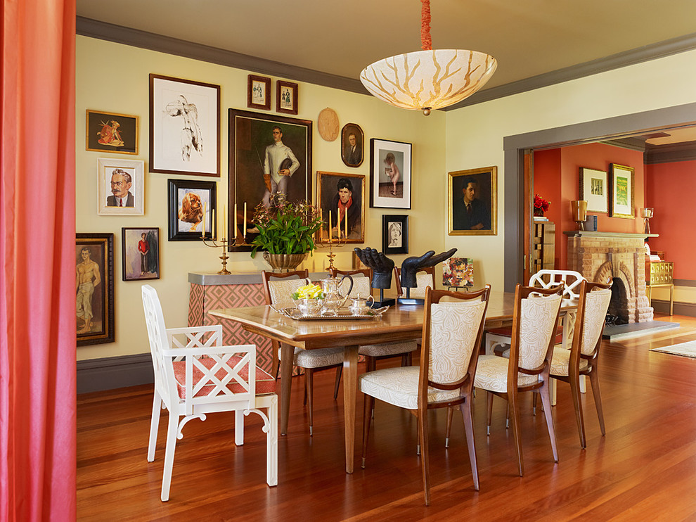 Inspiration for an eclectic dining room remodel in San Francisco with yellow walls