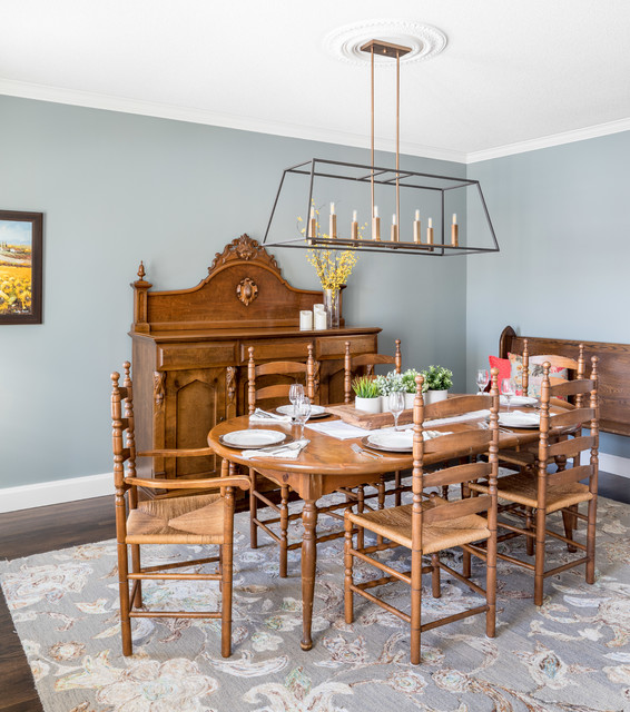 Example of a classic dark wood floor and brown floor enclosed dining room design in Toronto with blue walls