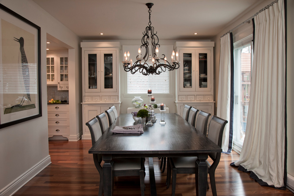 Inspiration for a timeless dark wood floor dining room remodel in Montreal