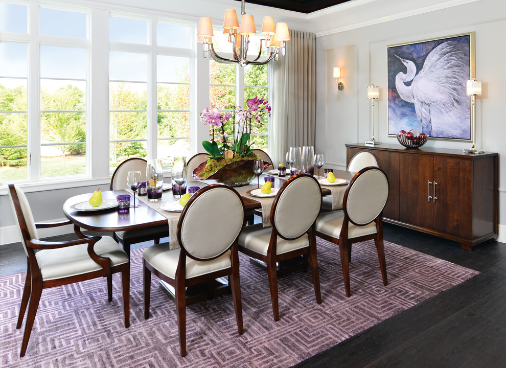 Example of a mid-sized trendy dark wood floor and black floor kitchen/dining room combo design in Detroit with white walls and no fireplace