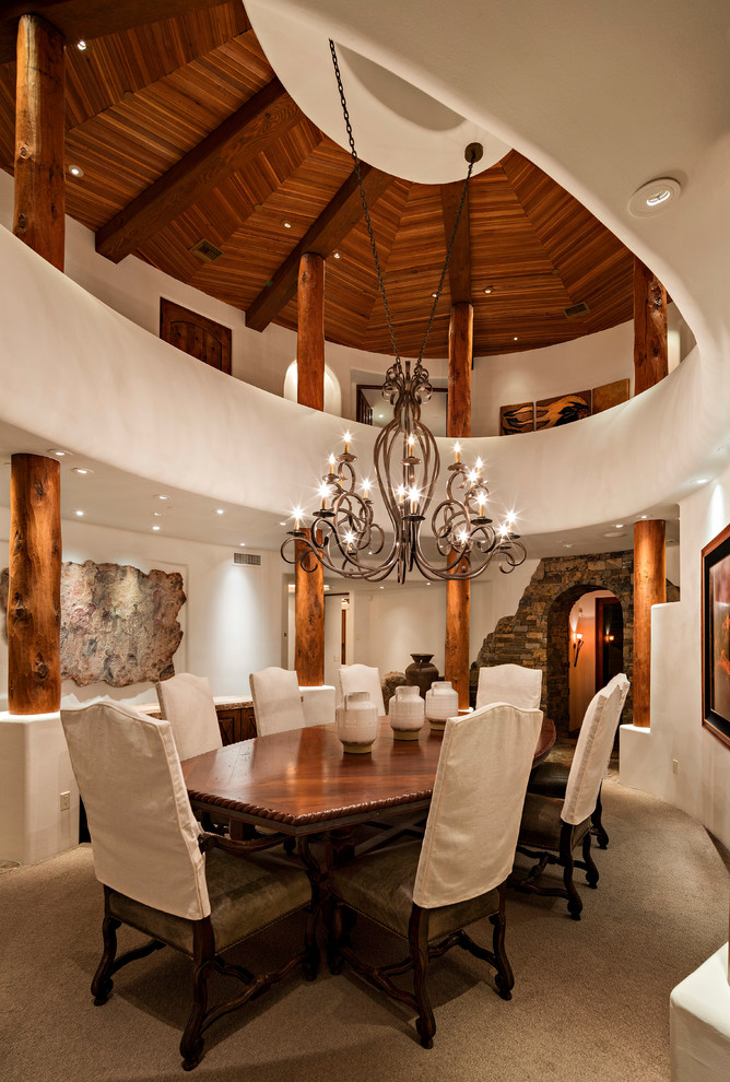 Example of a southwest beige floor dining room design in Phoenix with white walls