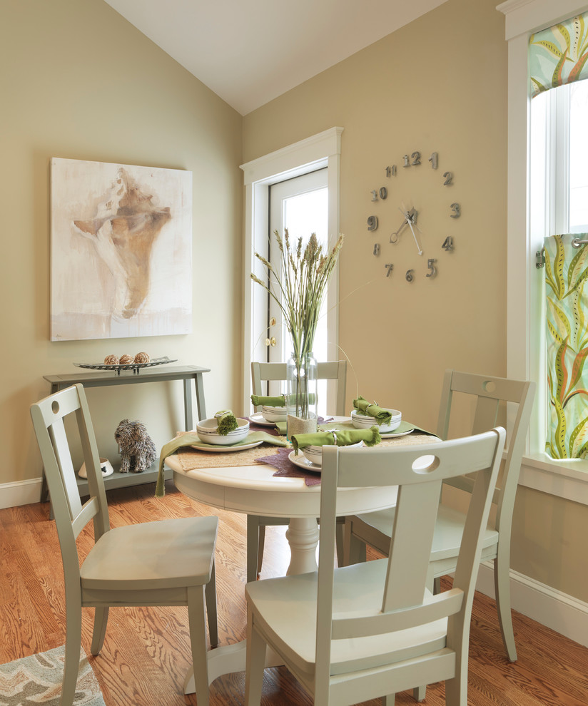 Kitchen/dining room combo - mid-sized contemporary medium tone wood floor and brown floor kitchen/dining room combo idea in Boston with beige walls and no fireplace