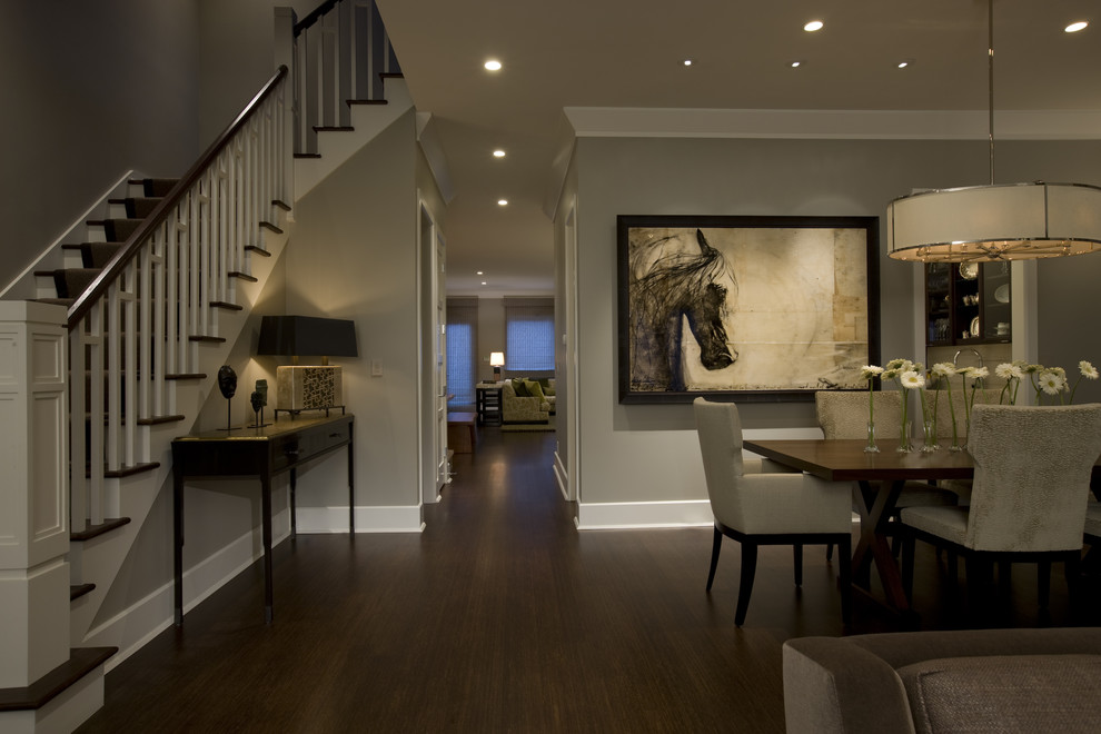 Elegant dark wood floor and brown floor dining room photo in Chicago with gray walls