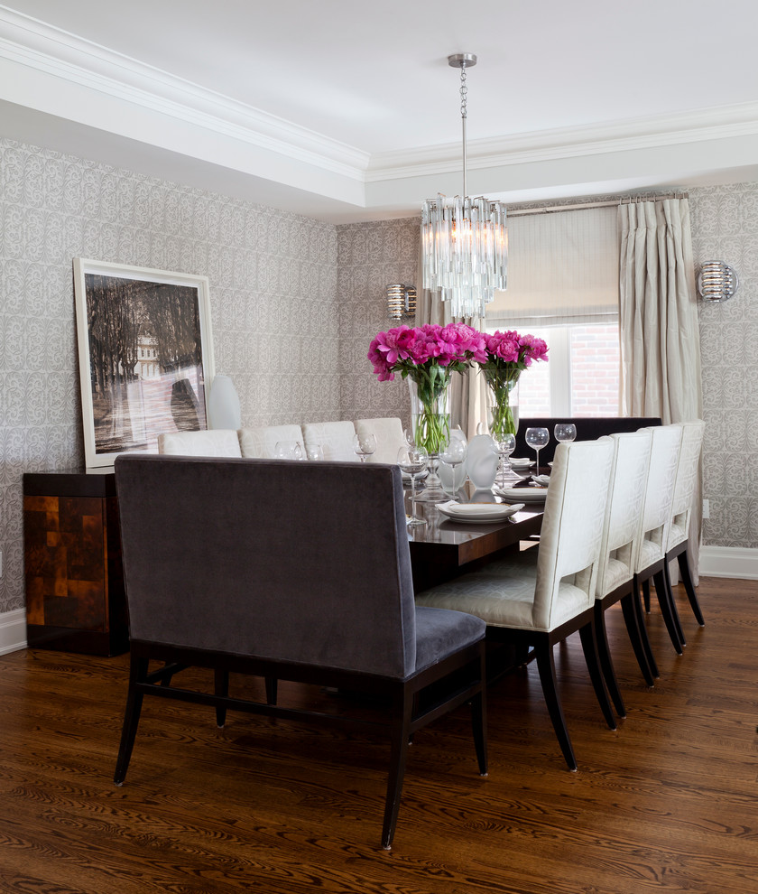 Transitional dark wood floor dining room photo in Toronto with gray walls