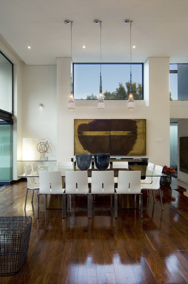Inspiration for a contemporary dark wood floor dining room remodel with white walls