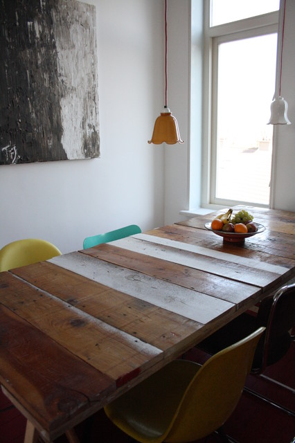 Example of an eclectic dining room design in Amsterdam