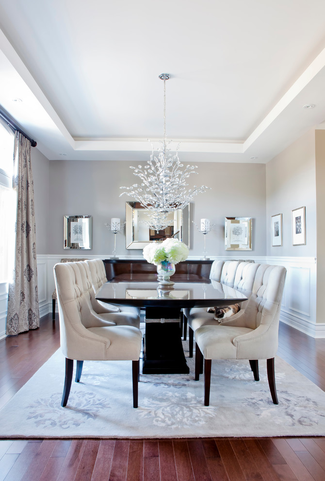 Example of a transitional brown floor dining room design in Montreal with gray walls and no fireplace