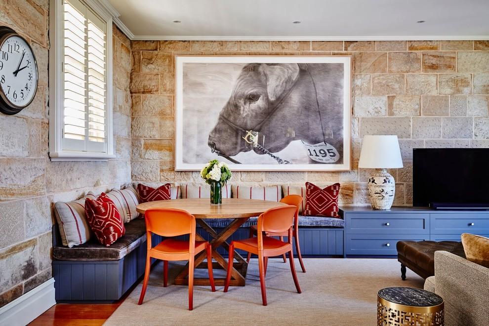 Great room - southwestern medium tone wood floor great room idea in Central Coast with beige walls