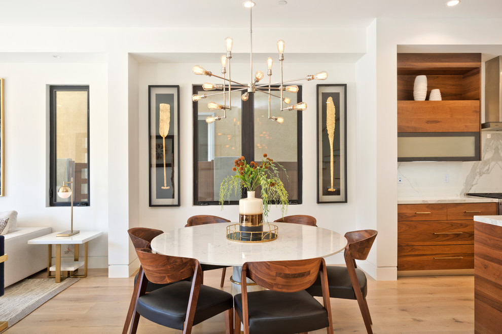 Inspiration for a mid-sized contemporary light wood floor and beige floor great room remodel in Orange County with white walls and no fireplace