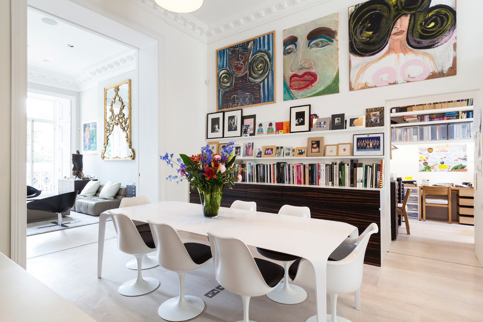 Dining room - contemporary light wood floor dining room idea in London with white walls