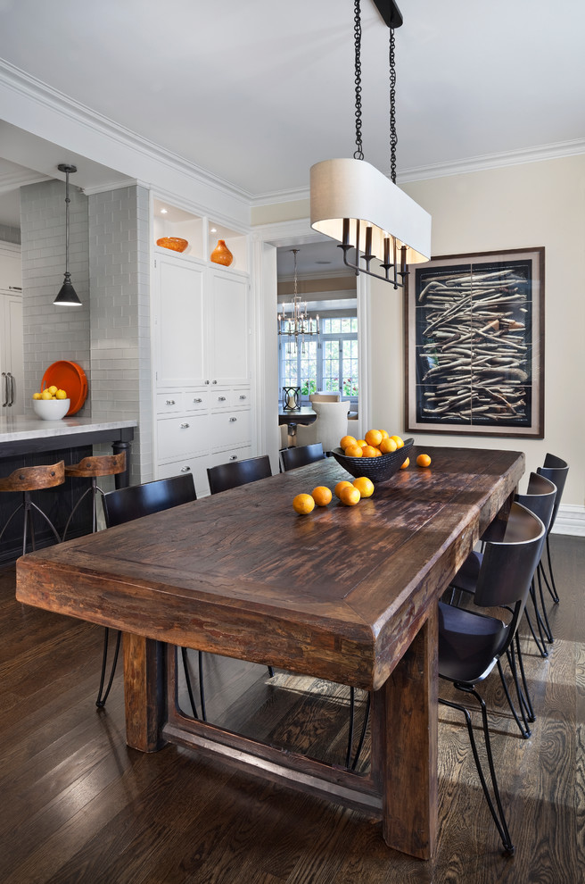 Example of a transitional dark wood floor and brown floor kitchen/dining room combo design in Chicago with beige walls
