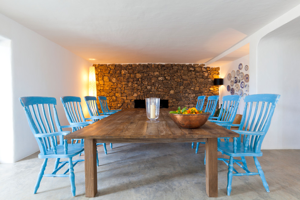 Tuscan gray floor dining room photo in London