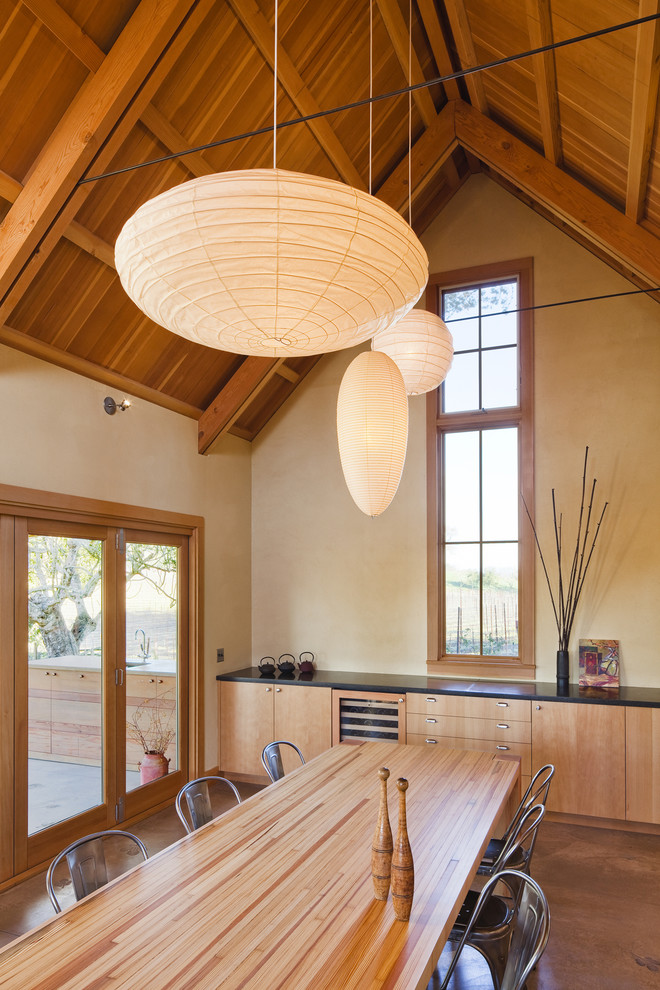 Example of a mid-sized country kitchen/dining room combo design in San Francisco with beige walls