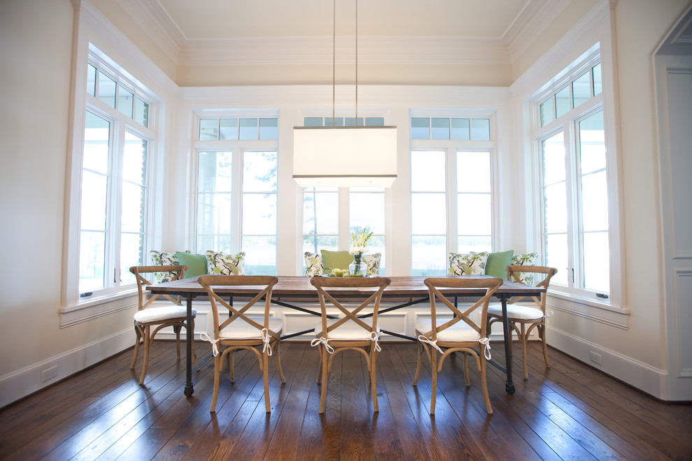 Elegant dark wood floor enclosed dining room photo in Houston with beige walls and no fireplace
