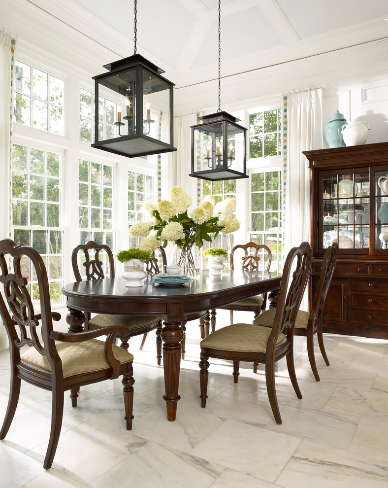 Dining room - traditional marble floor dining room idea in Atlanta with white walls