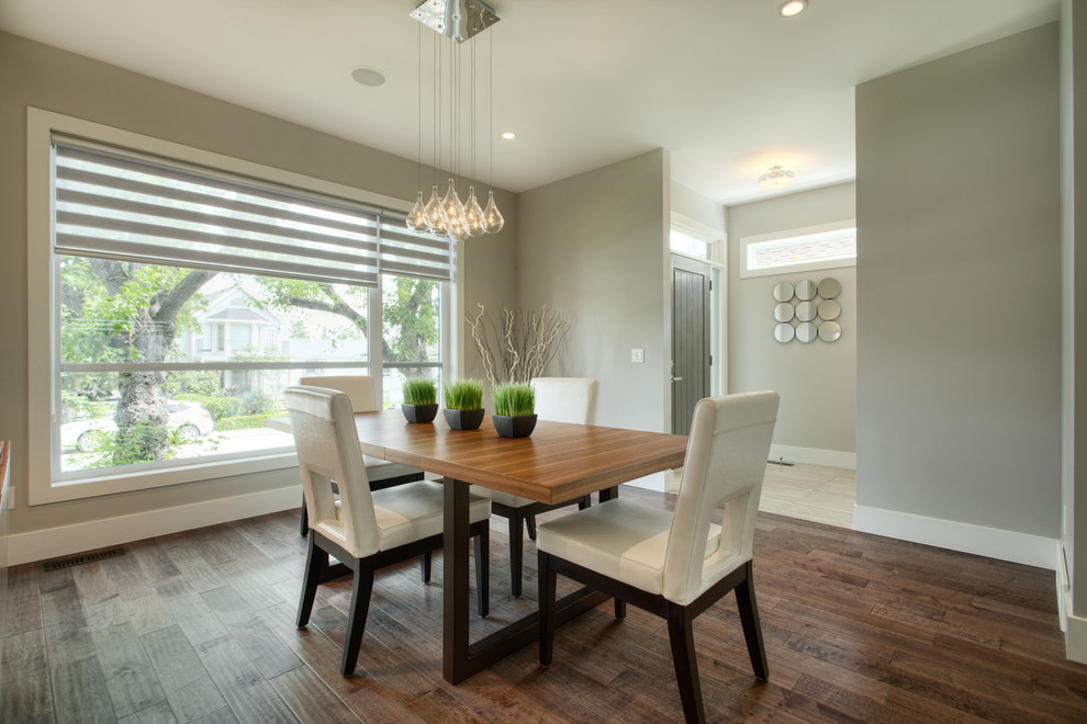 Inspiration for a contemporary dining room remodel in Calgary with gray walls
