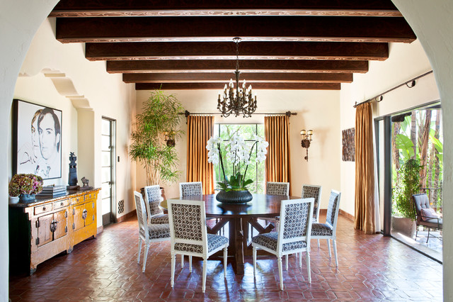 Example of a tuscan dining room design in Los Angeles with white walls and no fireplace