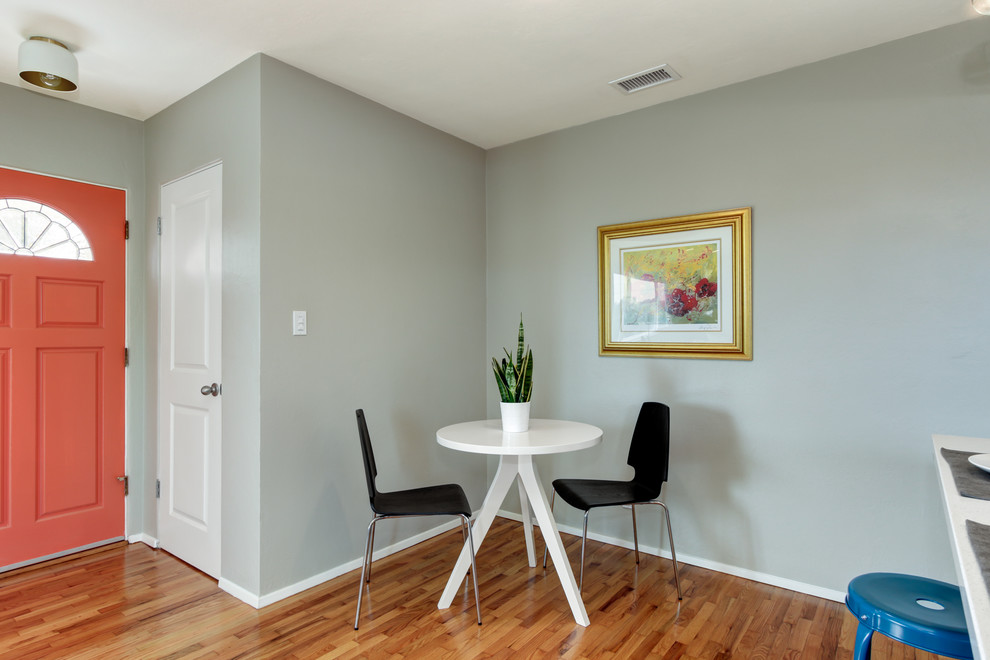 Example of a small minimalist light wood floor great room design in San Diego with gray walls and no fireplace